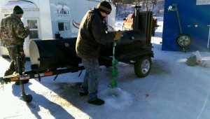 Testing the depth of the ice. 18 inches thick